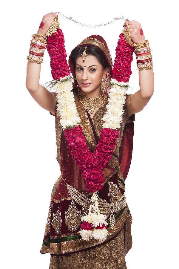 Portrait of a beautiful bride holding a garland Photograph by Sudipta Halder