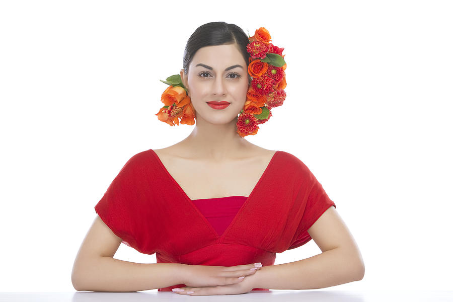 Portrait of a beautiful woman with flowers in hair Photograph by Sudipta Halder