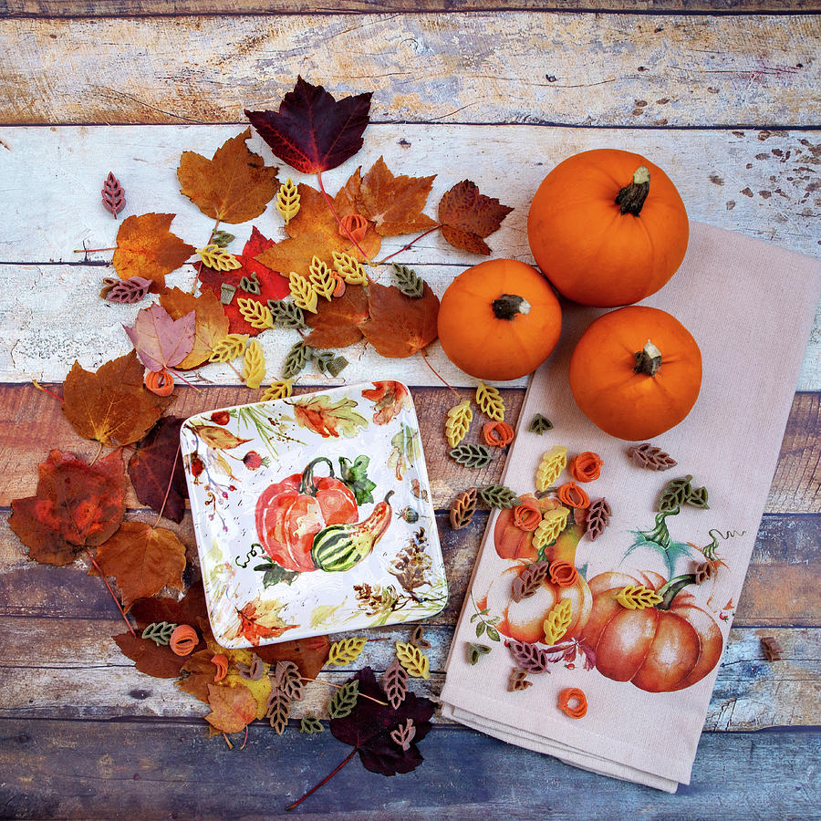 Pumpkins And Leaves Photograph