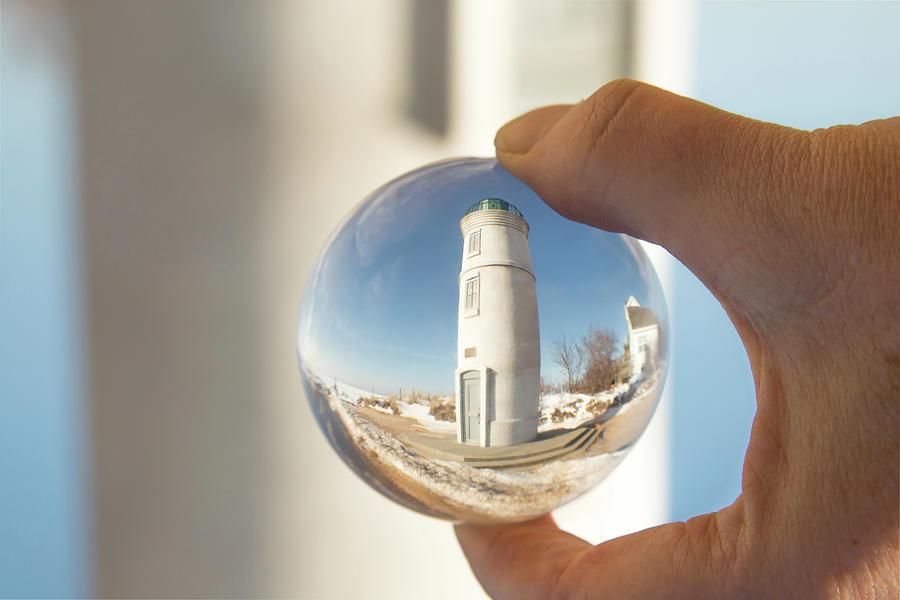 Robert H Manning Lighthouse, Empire, Michigan in winter reflecti by Karen Foley