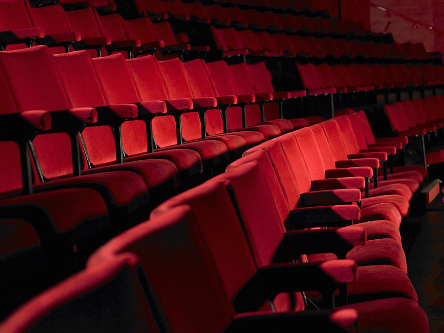 Rows of empty red cinema seats Photograph by Michael Blann