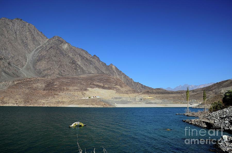 Satpara Lake with submerged PTDC motel sign Skardu Pakistan by Imran Ahmed