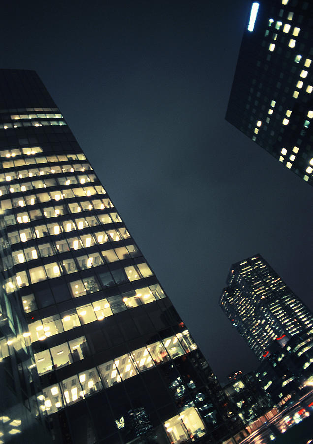 Skyscrapers at night, low angle view Photograph by Frederic Cirou
