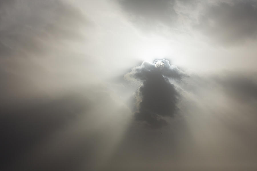 Sunlight through clouds Photograph by Jeremy Woodhouse