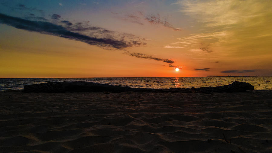 Lake Huron Photograph - Sunrise over Lake Huron with driftwood in Bay City Michigan by Eldon McGraw