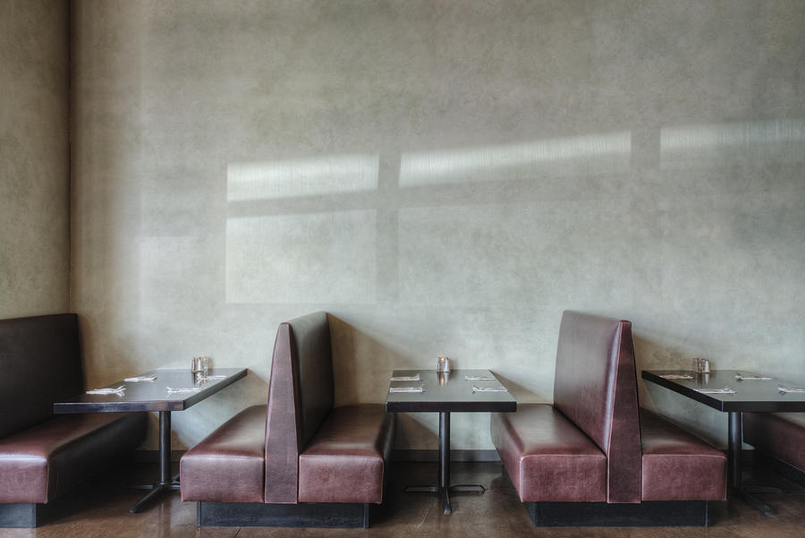 Tables and chairs in empty restaurant Photograph by Mint Images