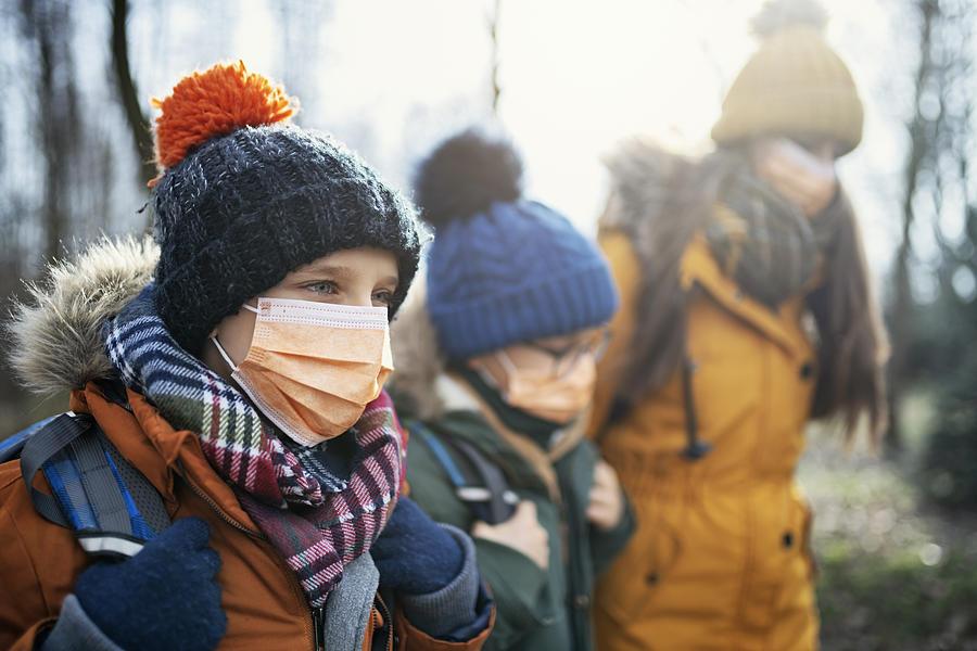 Three kids wearing anti virus masks going to school Photograph by Imgorthand