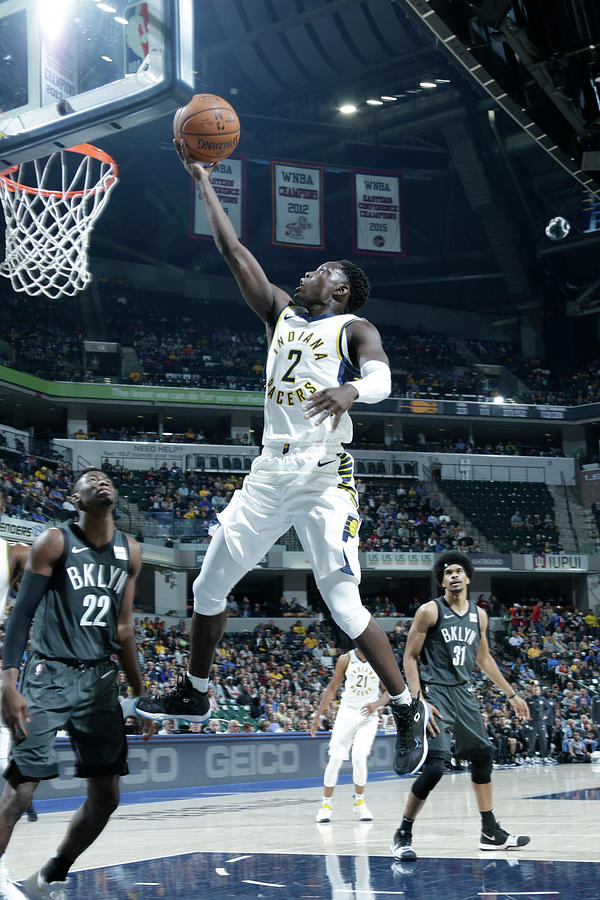 Darren Collison Photograph by Ron Hoskins
