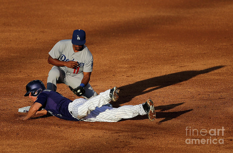 Nick Hundley and Jimmy Rollins Photograph by Doug Pensinger