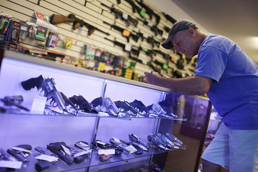 Obama Seeks To Tighten Loopholes In Gun Purchasing Regulations Photograph by Joe Raedle