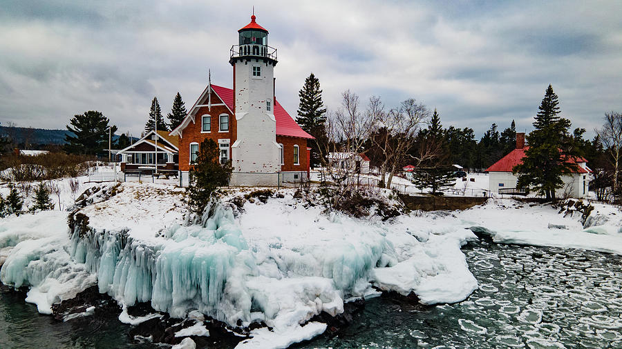 Lighthouses Photograph - Winter view of Eagle Harbor Lighthouse in Eagle Harbor Michigan by Eldon McGraw