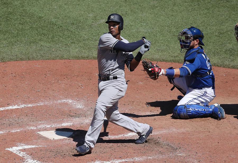 New York Yankees v Toronto Blue Jays Photograph by Tom Szczerbowski