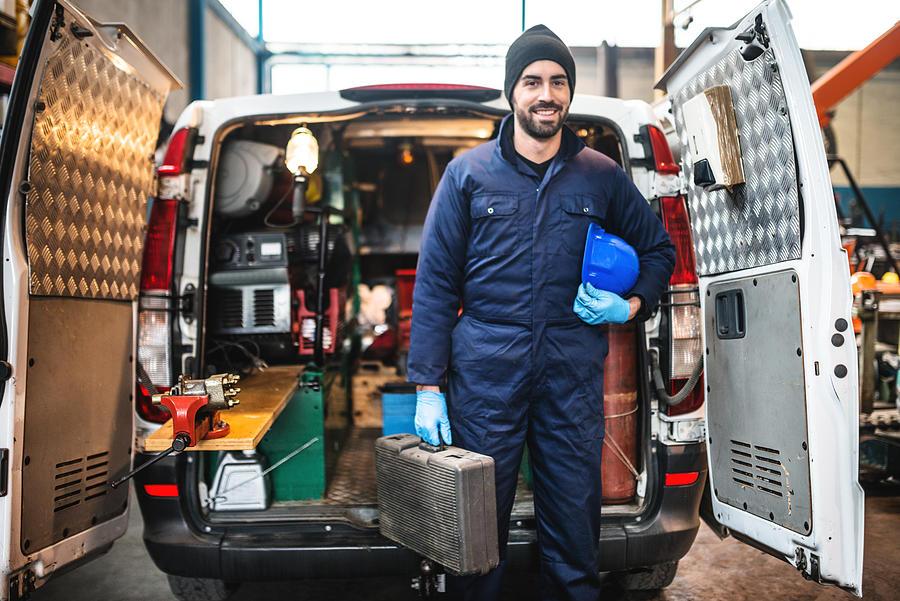 Mechanic Technician On A Garage Photograph by Franckreporter