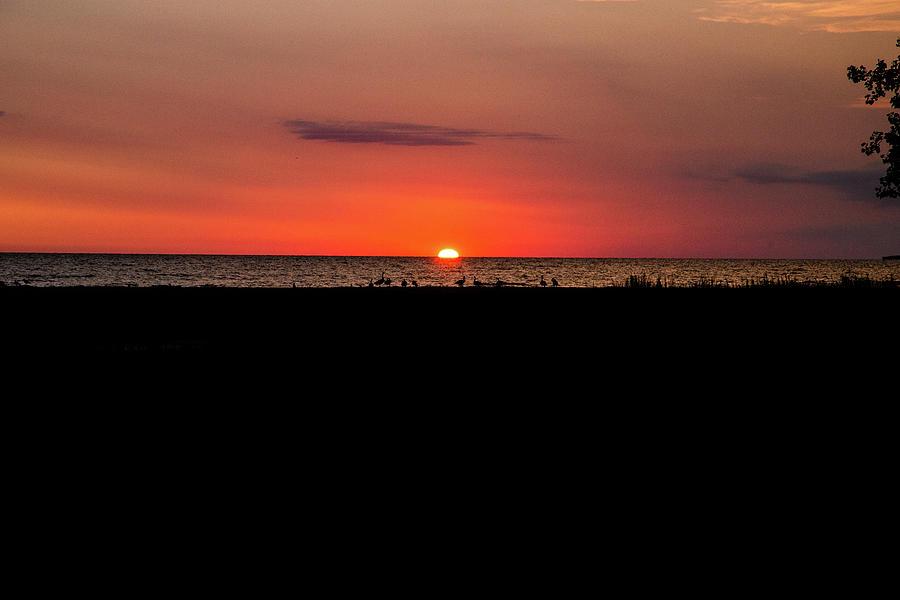 Lake Huron Photograph - Sunrise peaking over Lake Huron in Bay City Michigan by Eldon McGraw