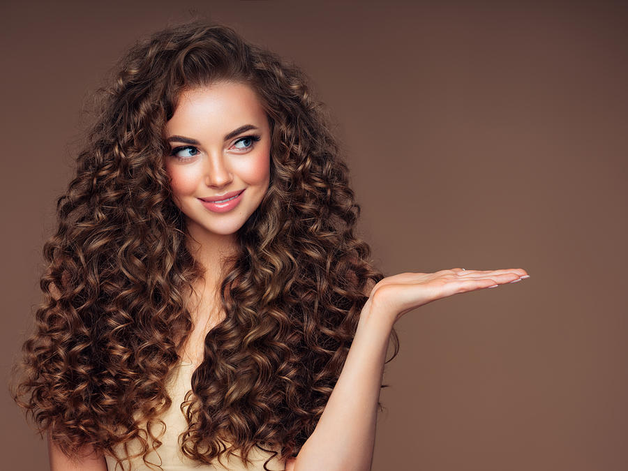 Beautiful woman with voluminous curly hairstyle Photograph by CoffeeAndMilk