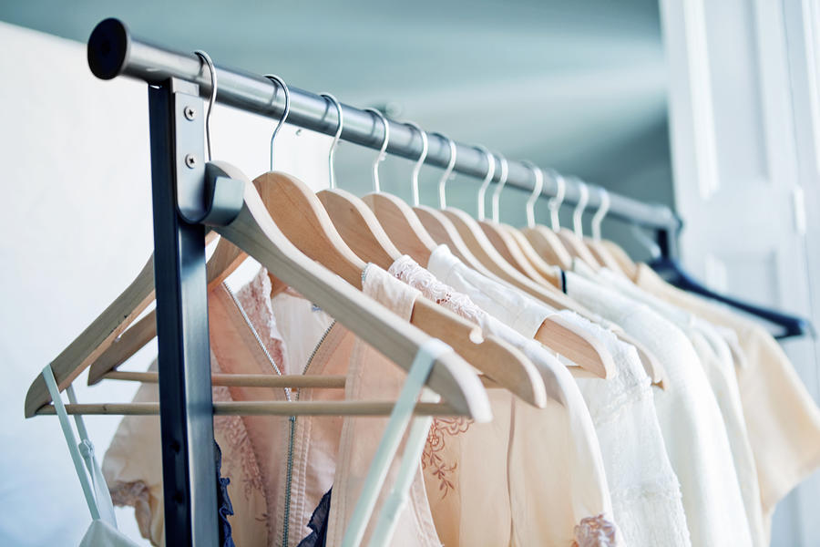 Hangers with clothes Photograph by Orbon Alija