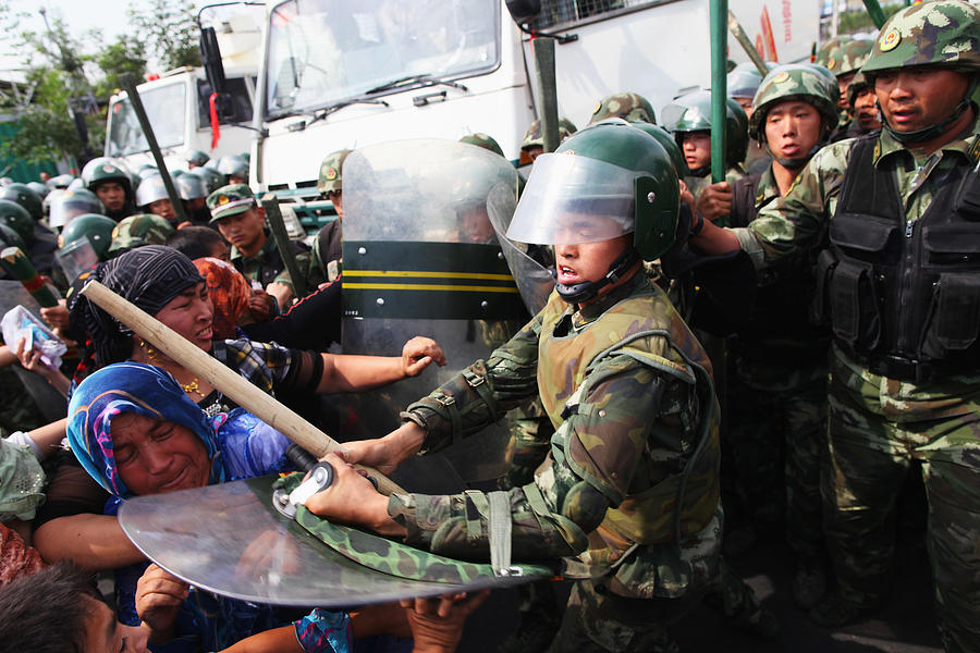 Riots Occur In Chinas Urumqi Ethnic Region Photograph by Guang Niu
