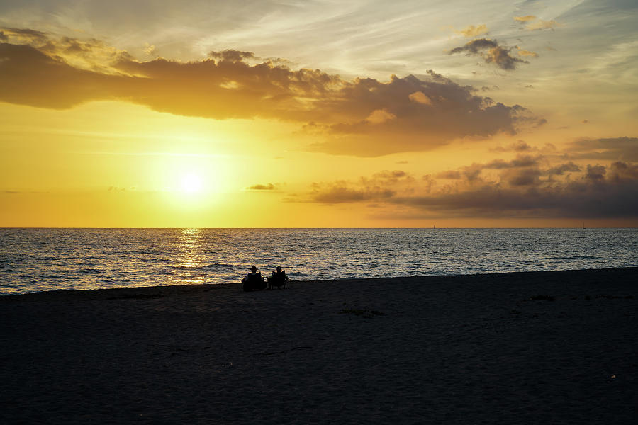 Beach Photograph - A Couple Watching the Sunset by Ric Schafer
