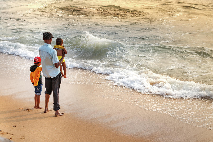 Beach Photograph - A Father Looking The Sea With His Kids At Galleface Beach In Col by Ruben Ramos