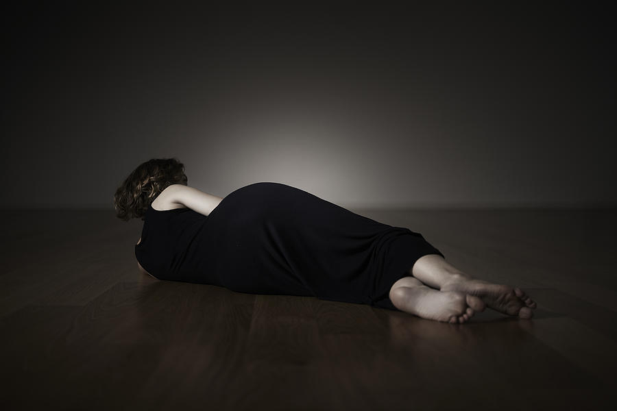 A Female Lying On The Floor Photograph by ModernewWorld