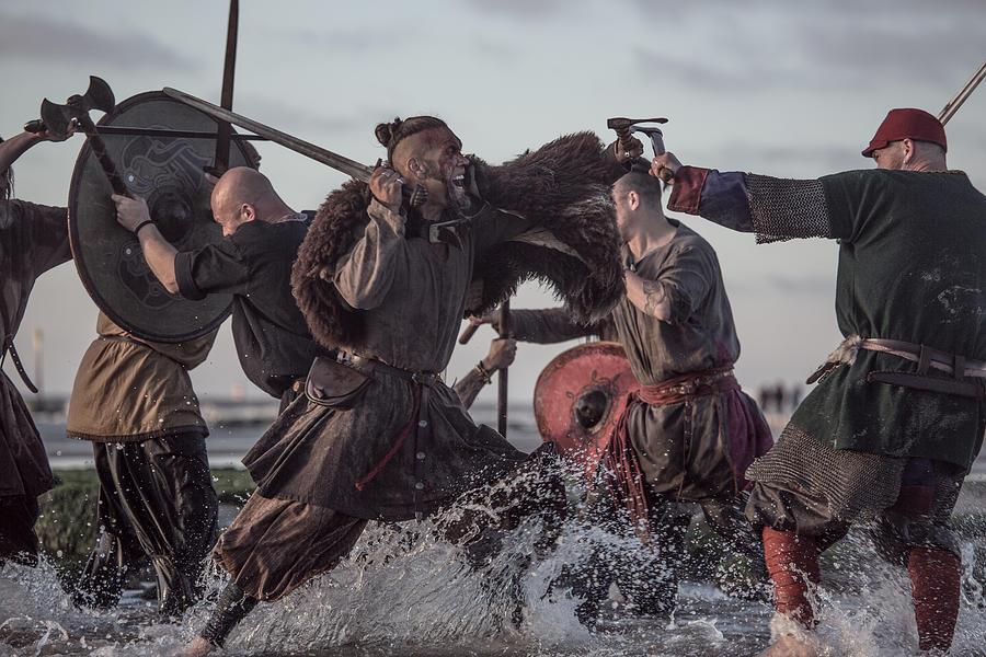 A Hoard Of Weapon Wielding Viking Warriors Fighting In A Battlefield Scene In The Sea Photograph by Lorado