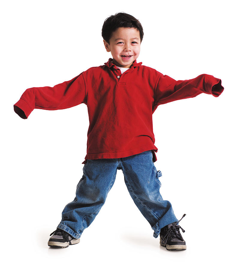 A Little Asian Boy In A Red Shirt With Long Sleeves Stand With His Arms Out And Feet Spread Apart Laughing Photograph by Photodisc