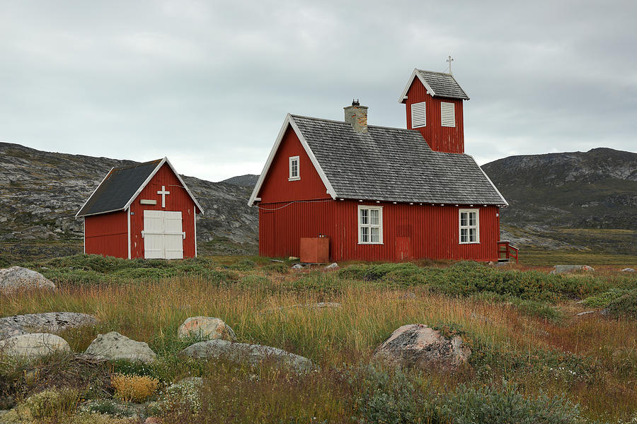A little red wooden church in an arctic landscape with cloudy sky Photograph by Rainer Grosskopf