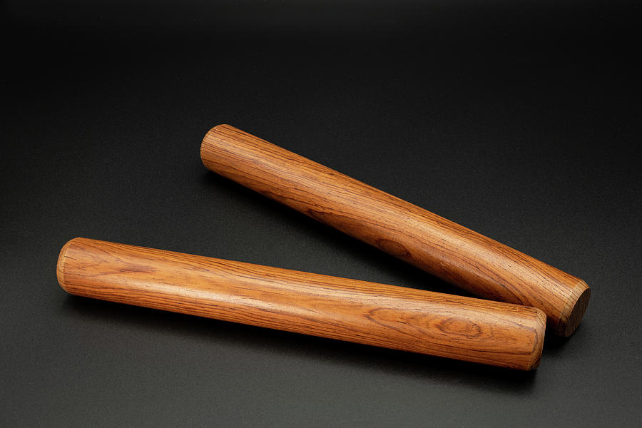 A Pair Of Wooden Claves Lying On A Black Underground Photograph