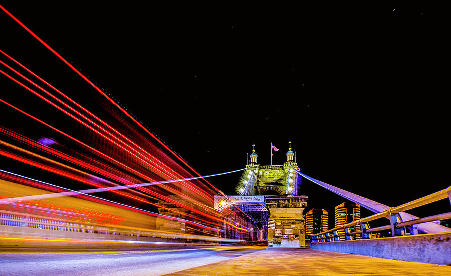 A Party Bus Crosses the Roebling Bridge Cincinnati Ohio by Dave Morgan