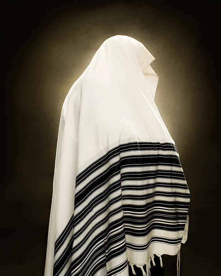 A rabbi wearing a prayer shawl Photograph by Image Source