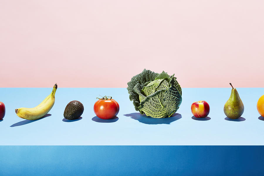 A row of different fruits and vegetables on a table top Photograph by Richard Drury