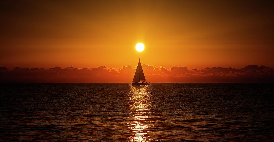 Life Photograph - A Sailboat Sailing The Sea by Vicen Photography