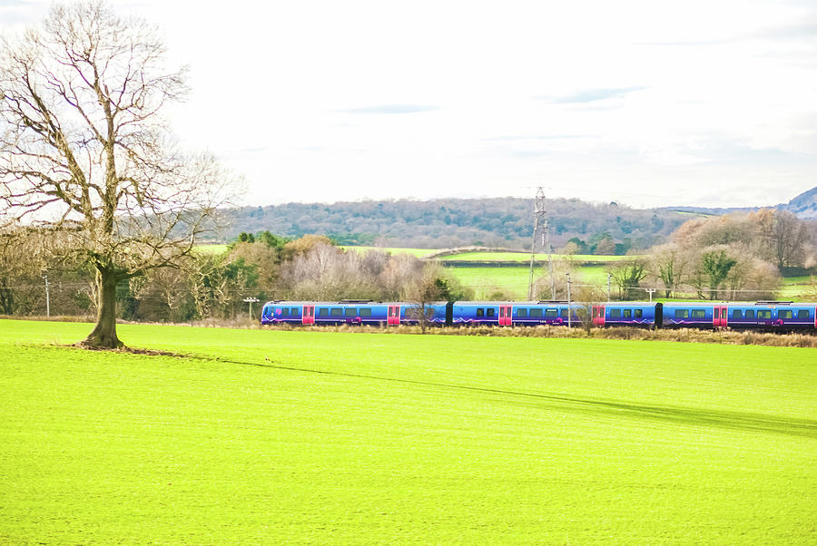 A Transpennine Express Passenger Train In The Countryside Uk Photograph