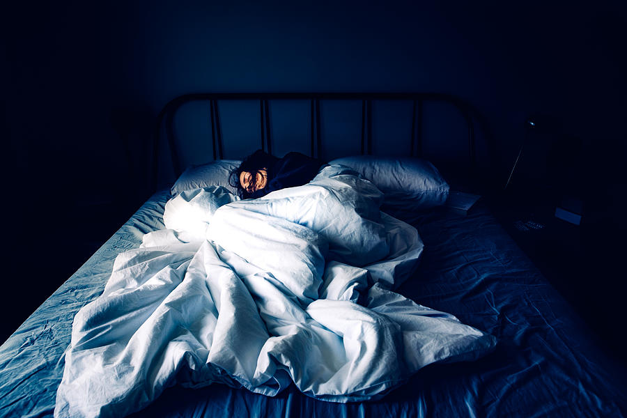 A woman sleeping in bed at night time Photograph by Photographer, Basak Gurbuz Derman