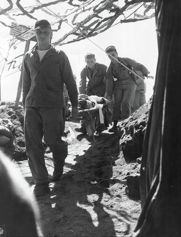 A Wounded Marine Is Brought To The Fourth Division Evacuation Hospital By His Comrades On Iwo Jima Painting