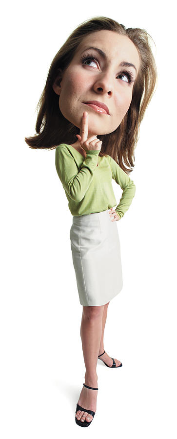 A Young Attractive Caucasian Female In A Tan Skirt And Green Blouse Stands Thinking With Her Finger To Her Chin Photograph by Photodisc