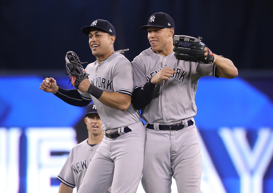 Aaron Judge and Giancarlo Stanton Photograph by Tom Szczerbowski