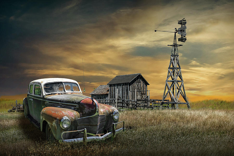 Abandoned Rusted Sedan By An Old Weathered Barn With Windmill At Photograph