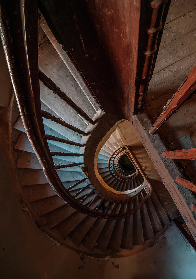 Abandoned spiral wooden staircase by Jaroslaw Blaminsky