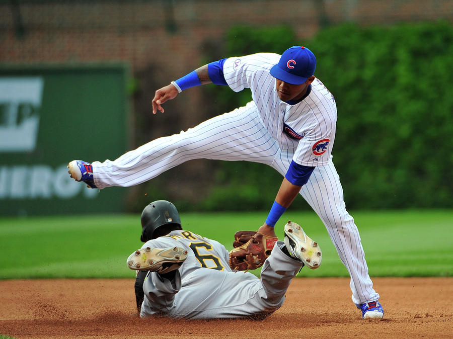Addison Russell and Starling Marte Photograph by David Banks