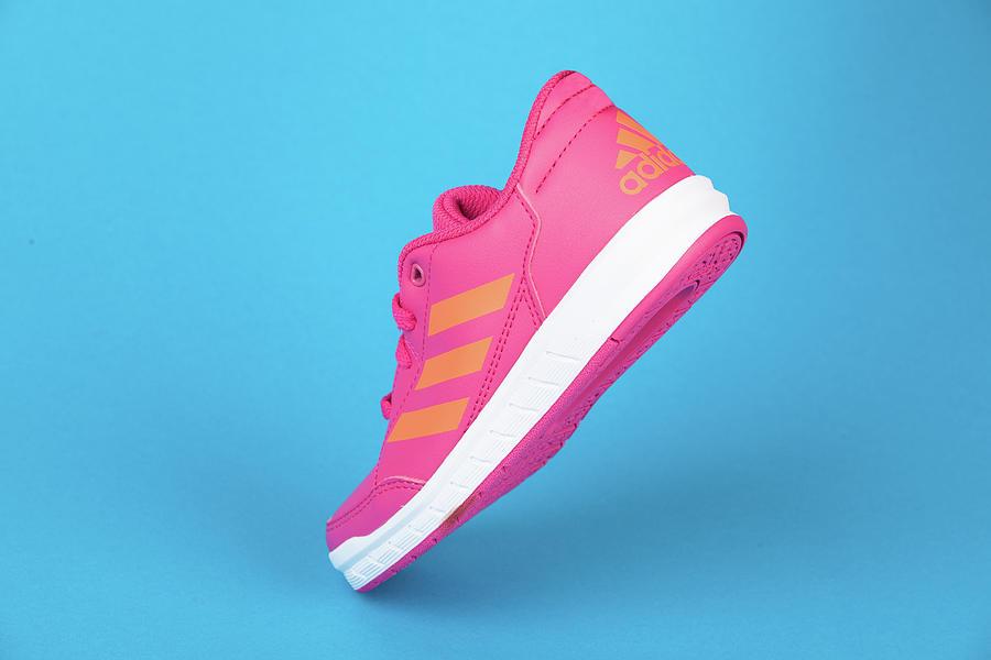 ADIDAS pink shoe, on blue background