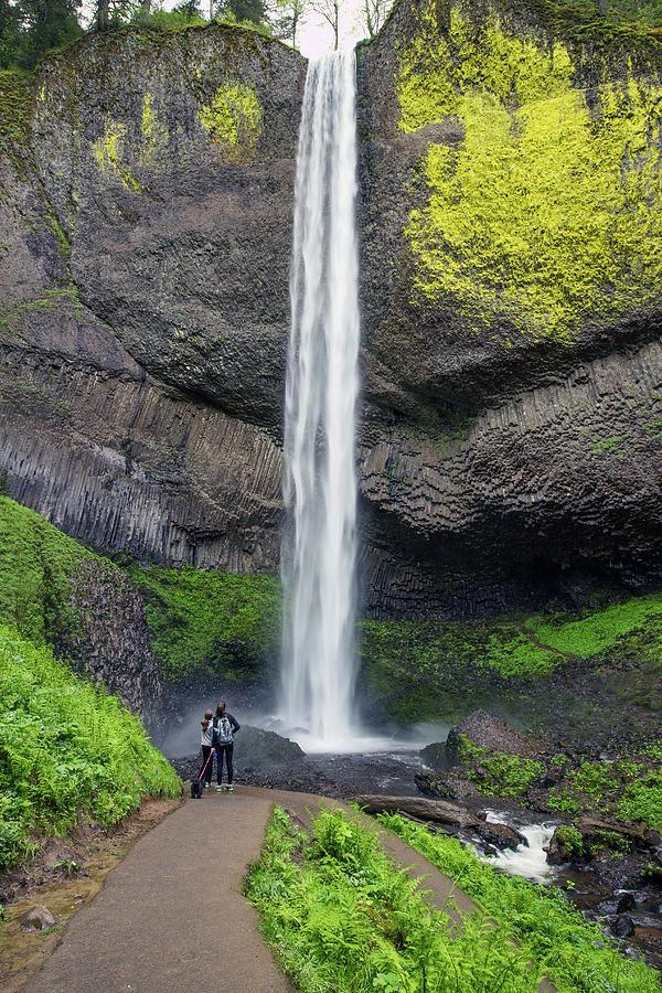 Admiring Latourell Falls by Harold Carlson