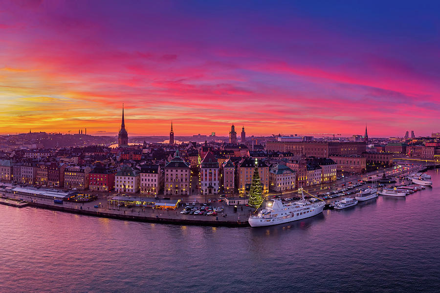 Fiery Photograph - Aerial view of a fiery sunset over the Stockholm Old City by Dejan Kostic