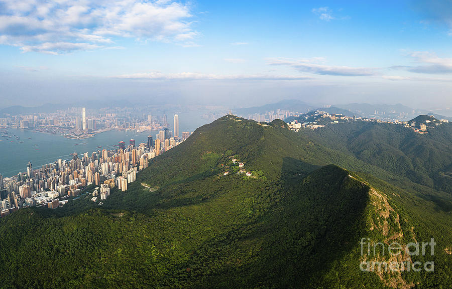 Aerial view of the stunning Victoria Peak in Hong Kong island wi by Didier Marti