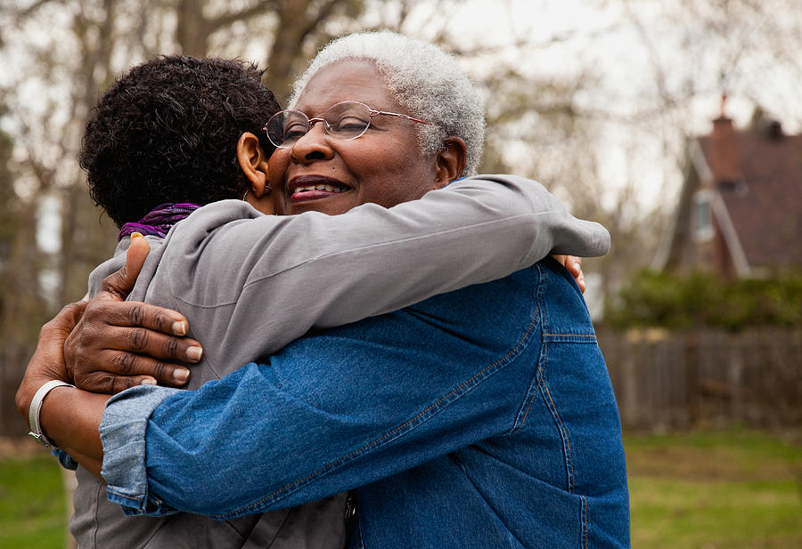 African American Senior Hugging Her Daughter Photograph by Ron Levine