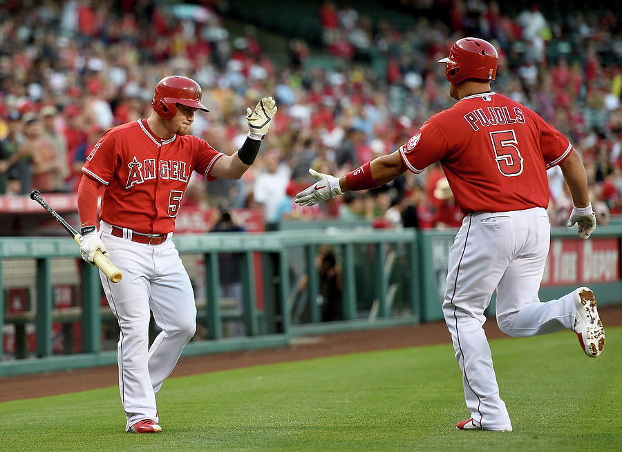 Albert Pujols and Kole Calhoun Photograph by Harry How