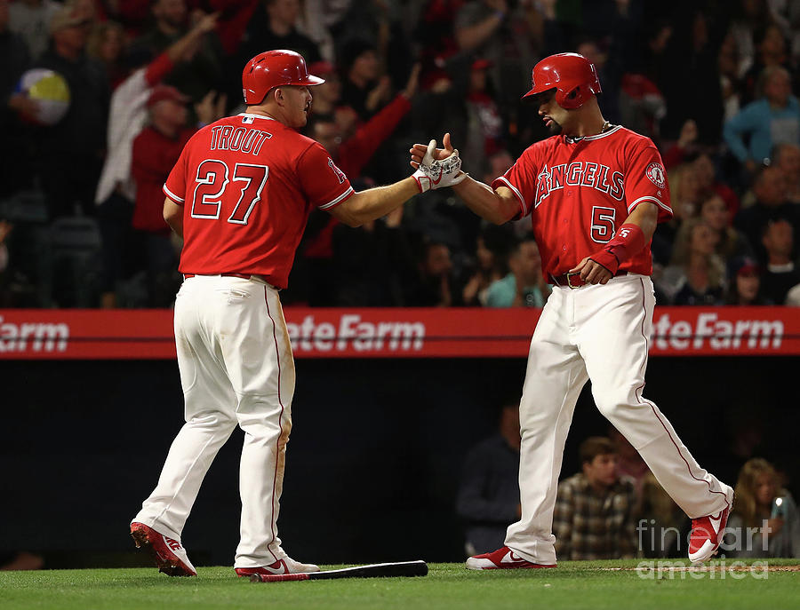 Albert Pujols, Andrelton Simmons, and Mike Trout Photograph by Victor Decolongon