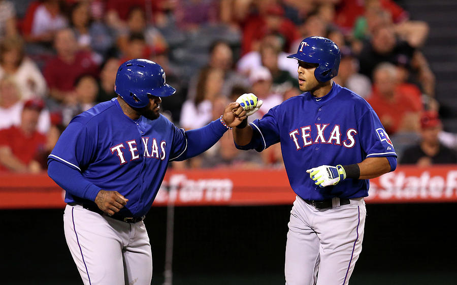 Alex Rios and Prince Fielder Photograph by Stephen Dunn