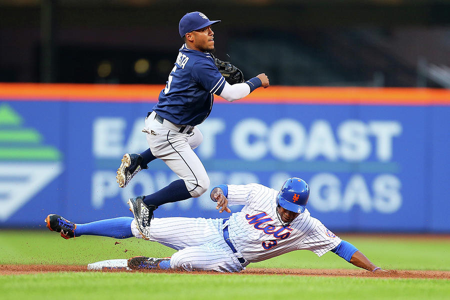Alexi Amarista and Curtis Granderson Photograph by Mike Stobe