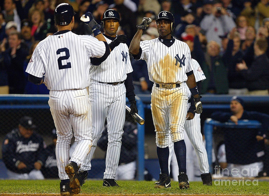 Alfonso Soriano, Derek Jeter, and Bernie Williams Photograph by Al Bello